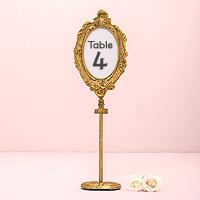 Le Cadre Ovale Baroque Doré Marque Table sur Pied